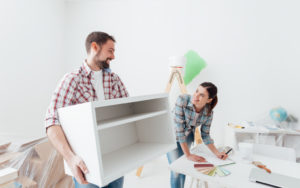 couple setting up a home office