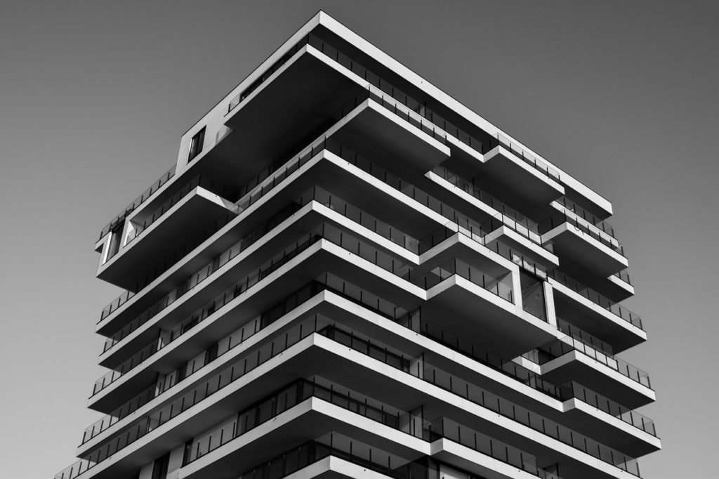 grayscale photo of concrete building modern architecture